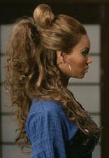 capelli ricci raccolti tempie